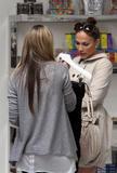 Jennifer Lopez ( Дженнифер Лопес) - Страница 2 Th_64927_Jennifer_Lopez_browses_through_baby_dresses_while_clothes_shopping_on_Robertson_Boulevard4_December_9_2009_-_06_122_393lo